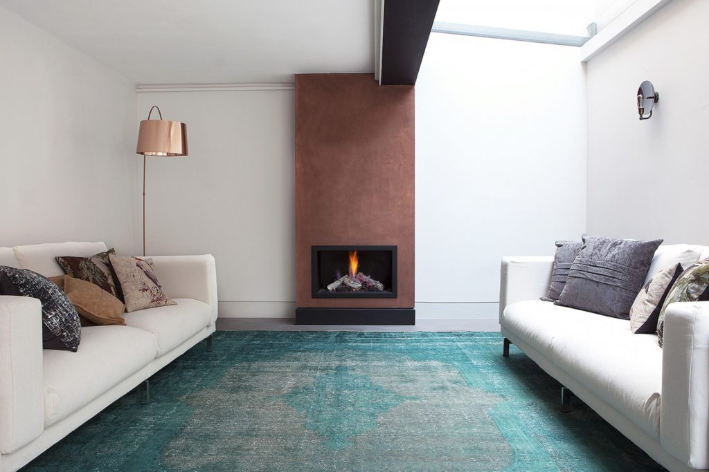 teal rug in living room