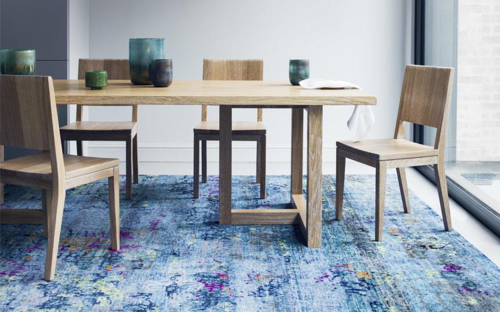 blue rug in dining room