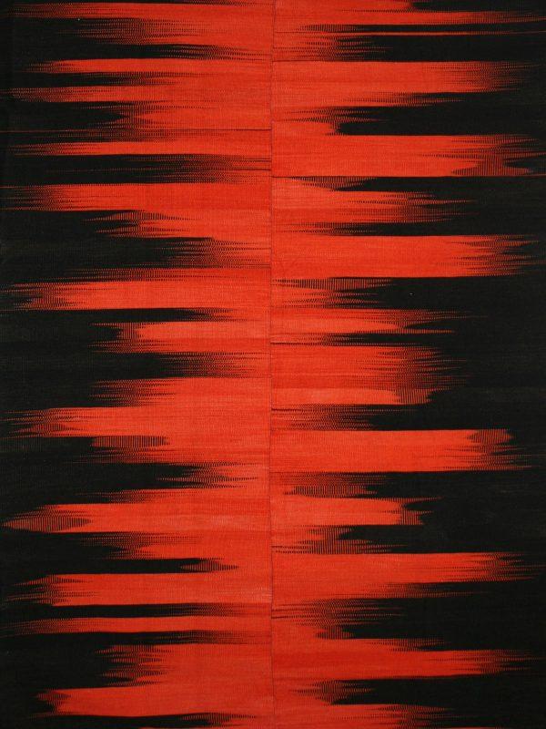 orange and black striped rug