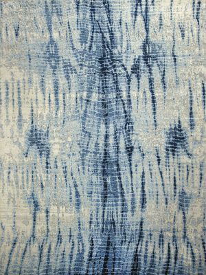 blue and cream luxury rug with tie-dye pattern