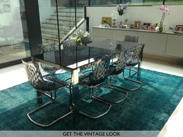 teal vintage rug in modern dining room