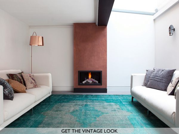 teal vintage rug with white sofa