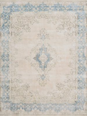 faded vintage persian rug with blue