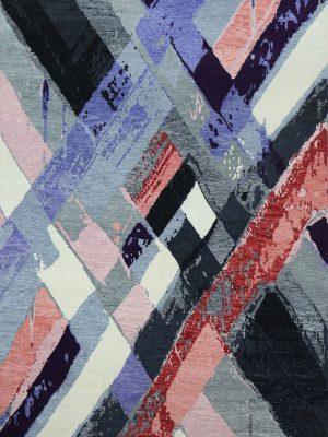 pink and purple rug with modern diamond design