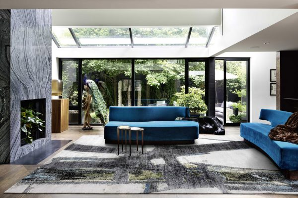 block no.07 rug in living room with blue sofas