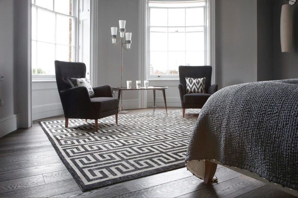 geometric rugs in bedroom