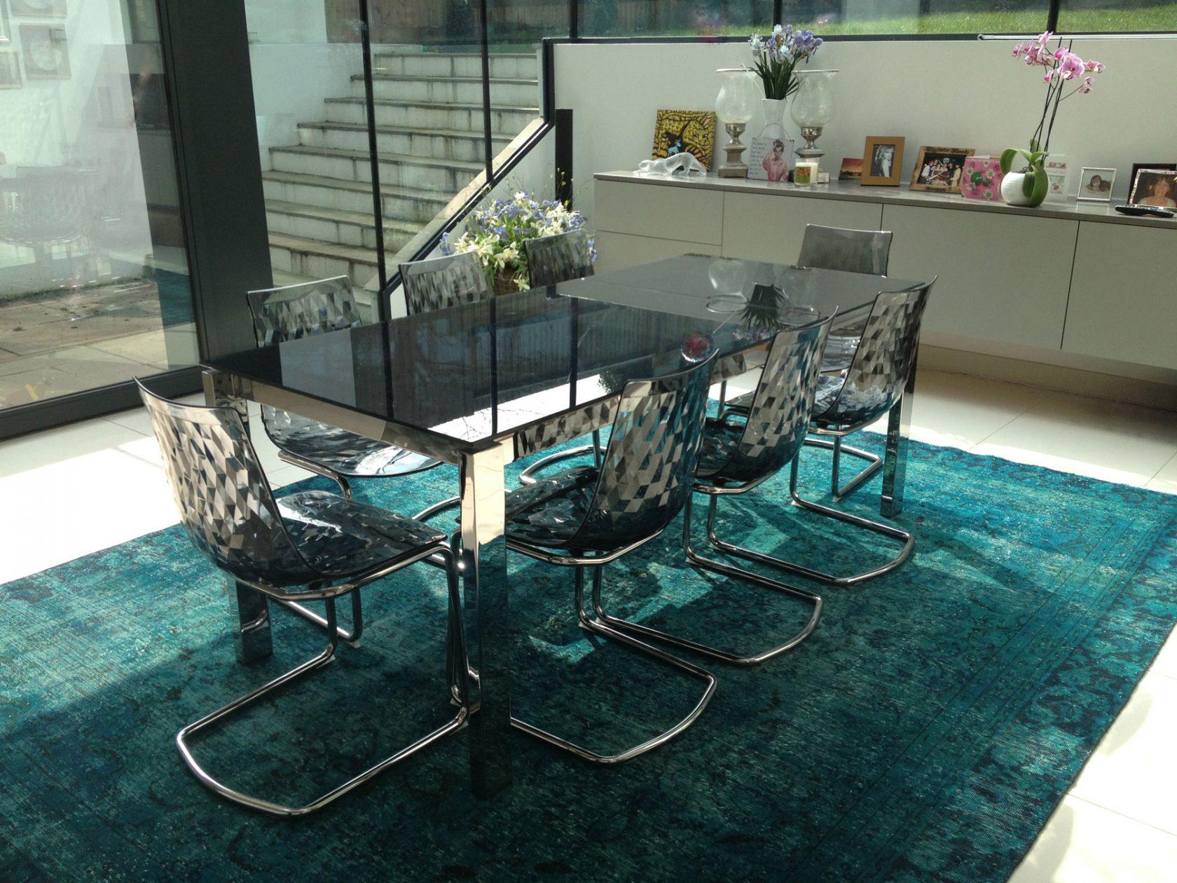 teal over-dyed vintage rug in dining room