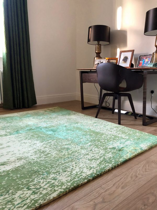 green rug in room