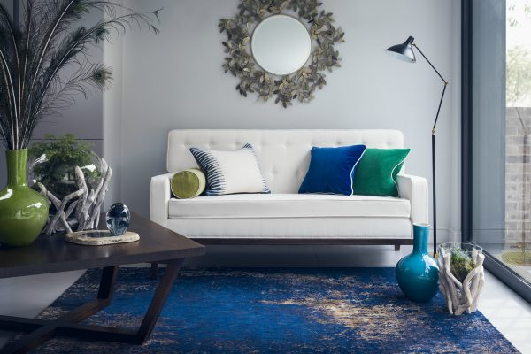 blue abstract rug in room