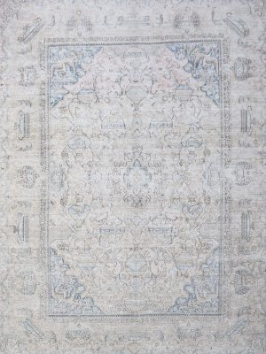 washed out persian vintage rug