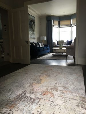 muted coloured abstract rug with luxurious wool and silk