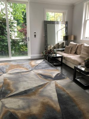 luxury wool and silk hand knotted rug with ceam sofa