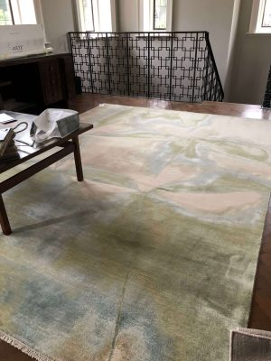 luxury handmade rug with wool and silk and green and blue design