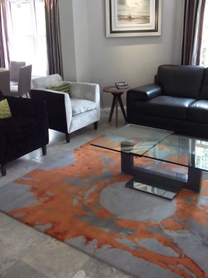 modern orange statement rug in living room