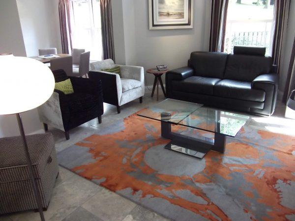 modern orange statement rug in living room