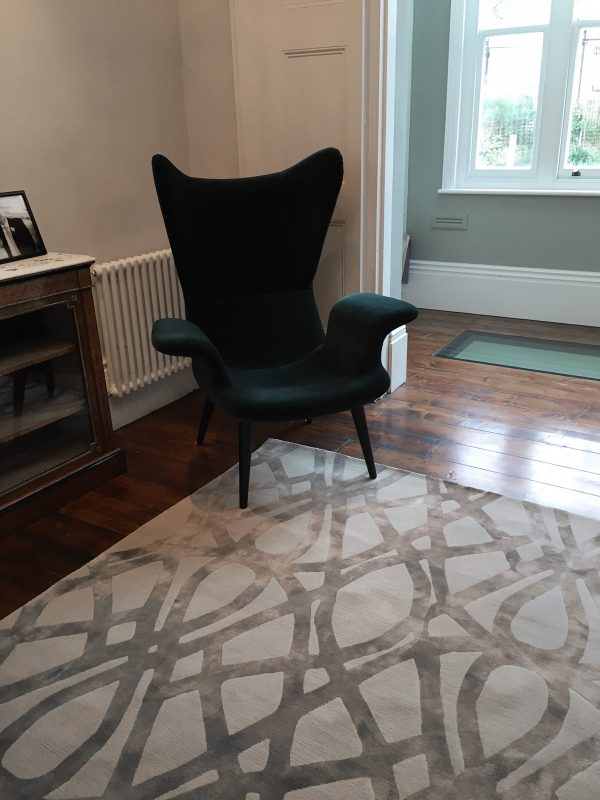 luxury rug in london home with green chair