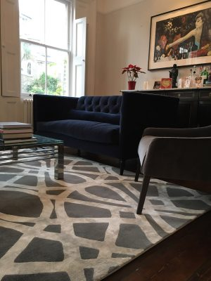 grey and silver luxury hand knotted rug with blue velvet sofa