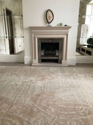 cream luxury rug with fireplace
