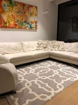 rug with cream geometric pattern and cream corner sofa