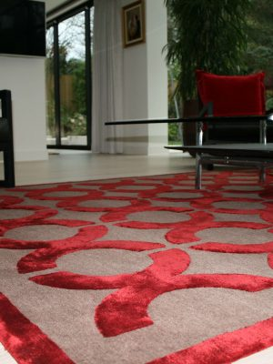 red silk geometric design rug with red chairs
