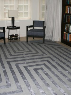 geometric rug with purple silk stripes