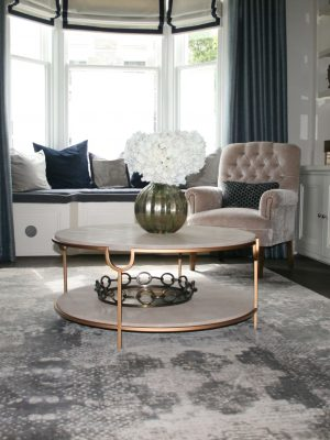silver silk modern rug with pattern in contemporary living room with bay window
