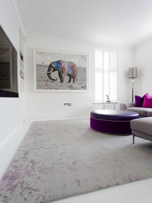 grey and purple rug in white room