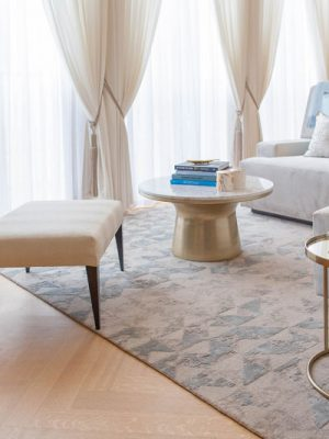 blue silk and cream rug in luxury living room by kathryn levitt design