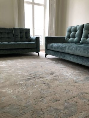 modern luxury rug with teal velvet sofa