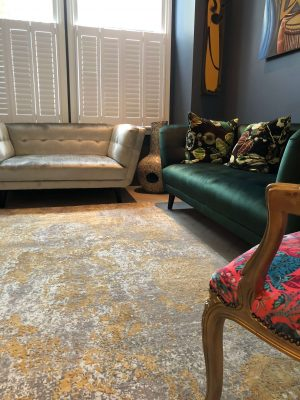 gold silk abstract rug in colourful living room