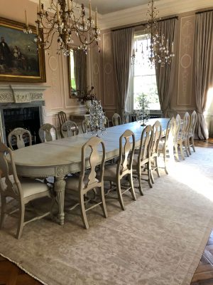 vintage persian rug in large classic dining room