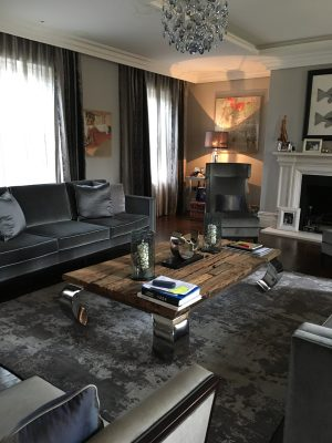 dark grey wool and silk rug in living room with grey velvet sofa