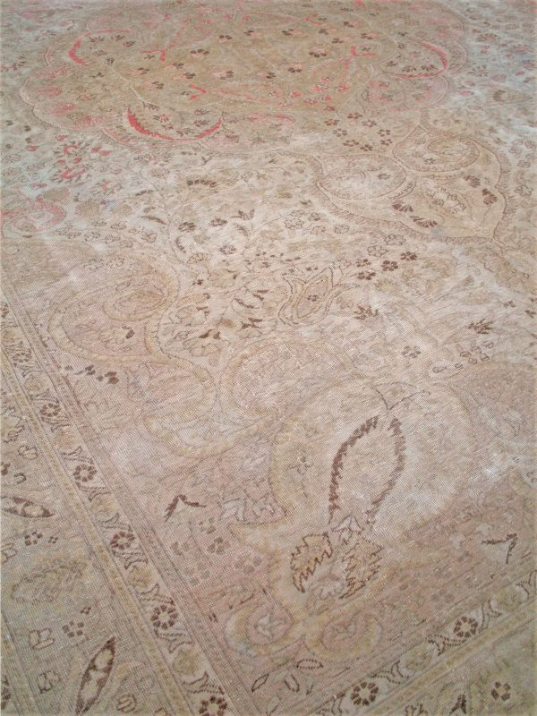 faded vintage rug with red pattern