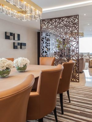 grey geometric rug in dinign room by katherine levitt design with tan leather chairs