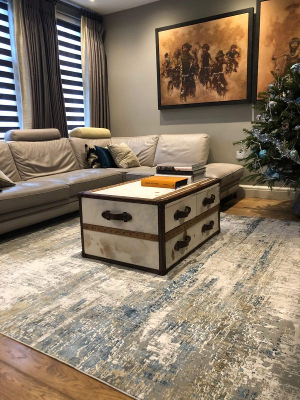 blue and white abstract rug in living room