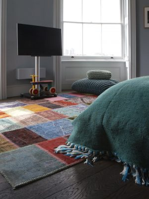 multi-coloured patchwork rug in room