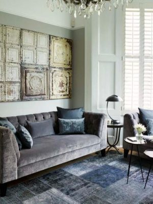 blue vintage patchwork rug in living room by Caz Myers