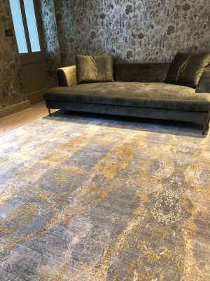 luxury wool and silk rug with velvet sofa