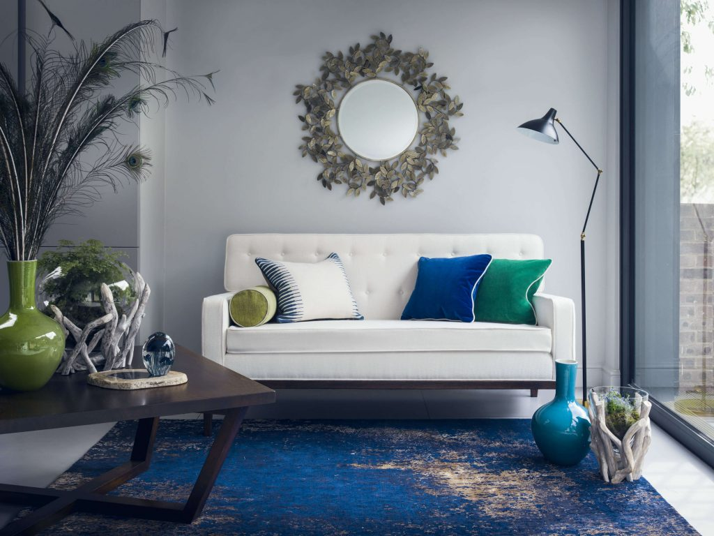 blue and copper luxury rug with white sofa by I&JL Brown