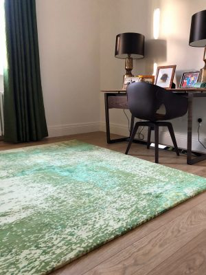green abstract rug in study