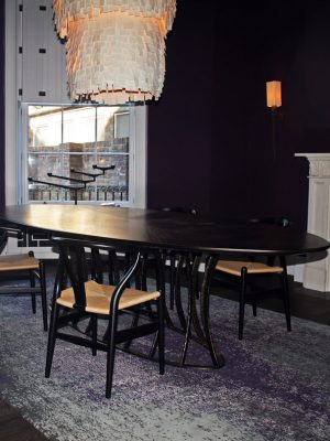 purple abstract rug in dining room with purple walls