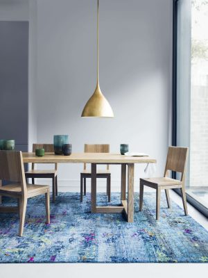 blue modern rug with wooden table by I&JL Brown