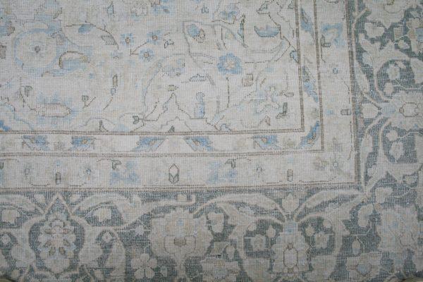 corner of vintage persian rug