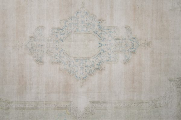 faded vintage rug with distressed pile
