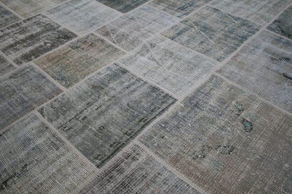 khaki patchwork rug close up