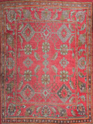 square antique rug with red oushak design