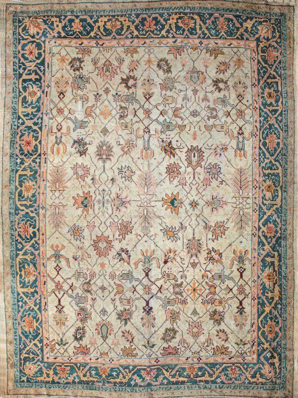 antique Ushak rug with ivory and blue tones
