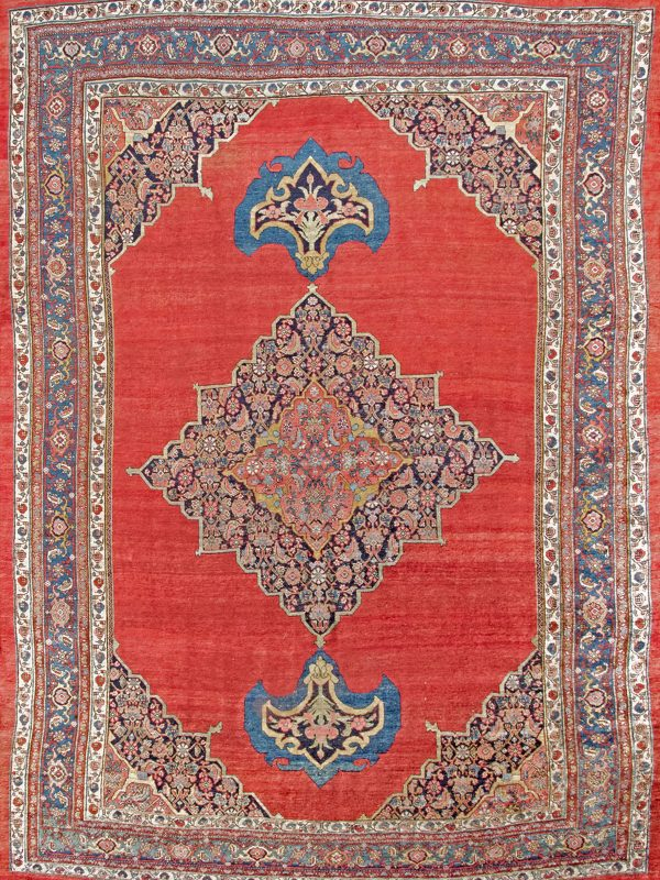 red and blue antique rug with central medallion