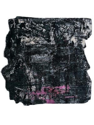 modern black and pink rug with uneven jagged edges in grungy style