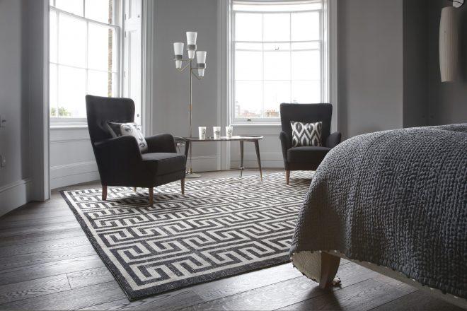black and white geometric rug in room